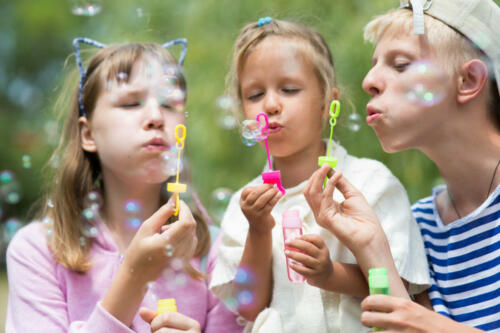 children blowing soap bubbles