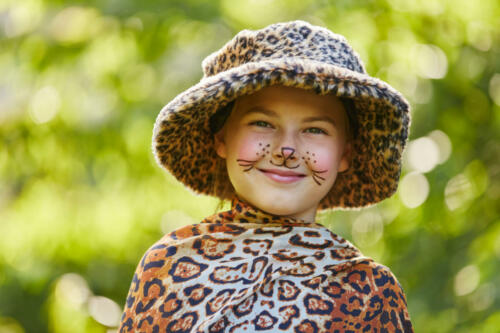 Girl with leopard face paint and costume